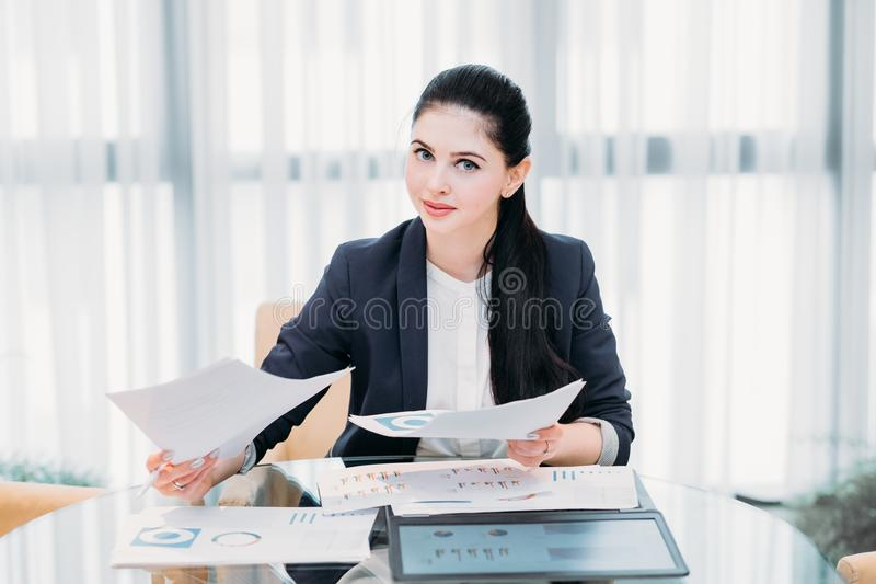 Business lady work manager documents office. Business lady at work. company manager. woman looking through documents in office. professional corporate dresscode stock photo