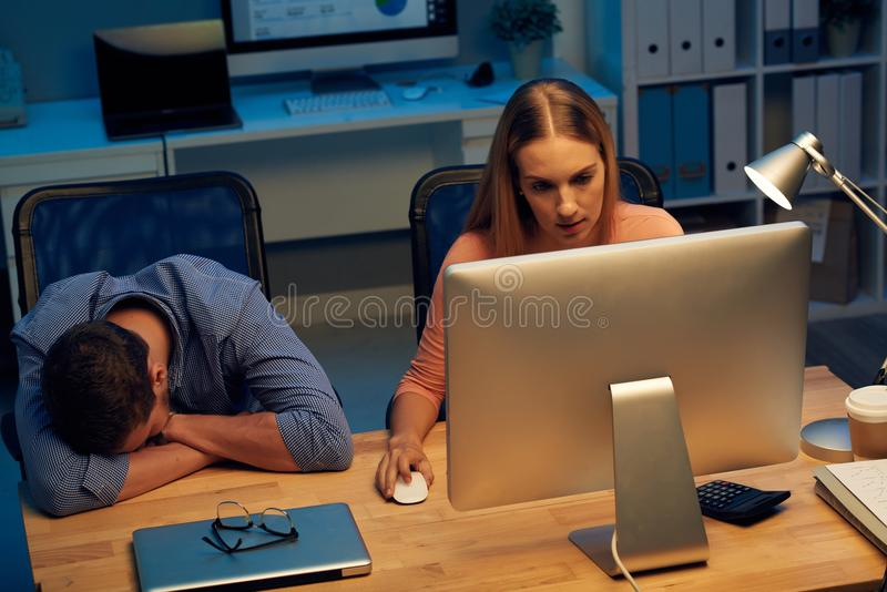 Business people working till sunrise stock photo