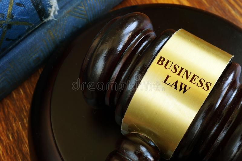 Business law sign on a gavel on desk royalty free stock image