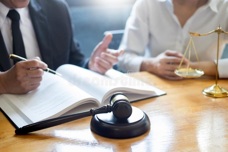 Business lawyer judge working about legal legislation Consultation with insurance with gavel and balance for deciding on marriage royalty free stock photography