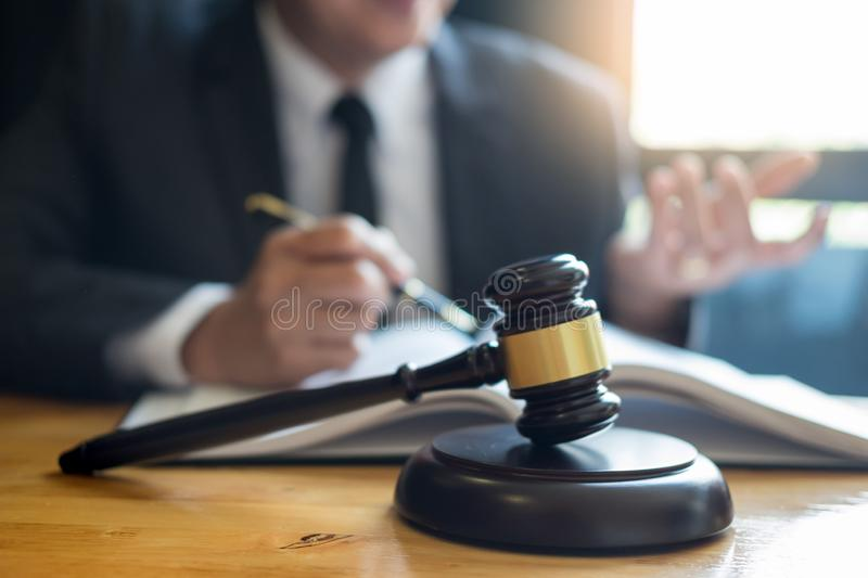 Business lawyer judge working about legal legislation Consultation with insurance with gavel and balance for deciding on marriage royalty free stock photo