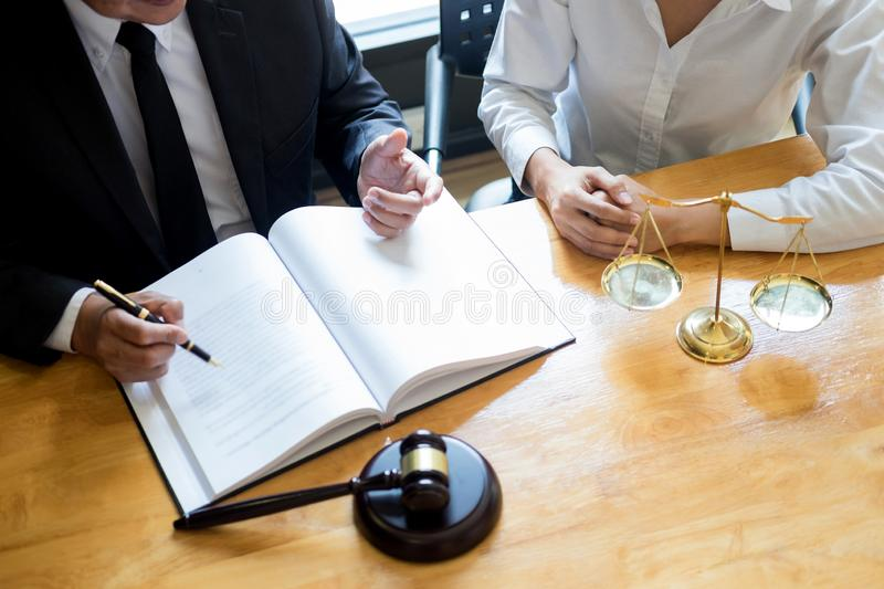 Business lawyer judge working about legal legislation Consultation with insurance  with gavel and balance for deciding on marriage stock images