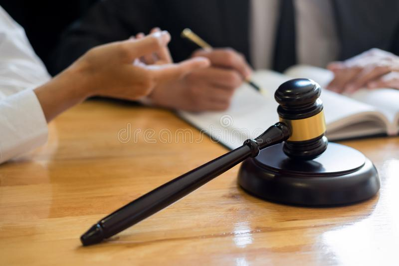 Business lawyer judge working about legal legislation Consultation with insurance  with gavel and balance for deciding on marriage stock photos