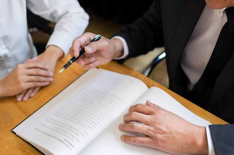 Business lawyer judge working about legal legislation Consultation with insurance  with gavel and balance for deciding on marriage royalty free stock image