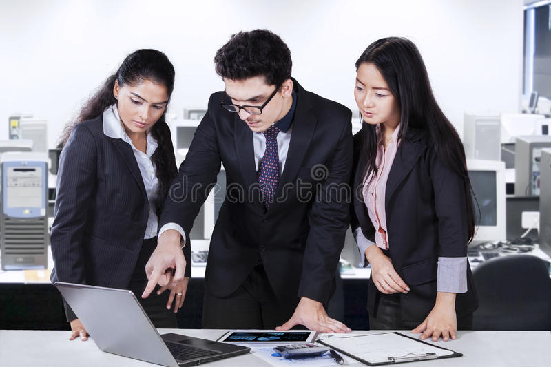 Business leader displaying document on laptop stock photo