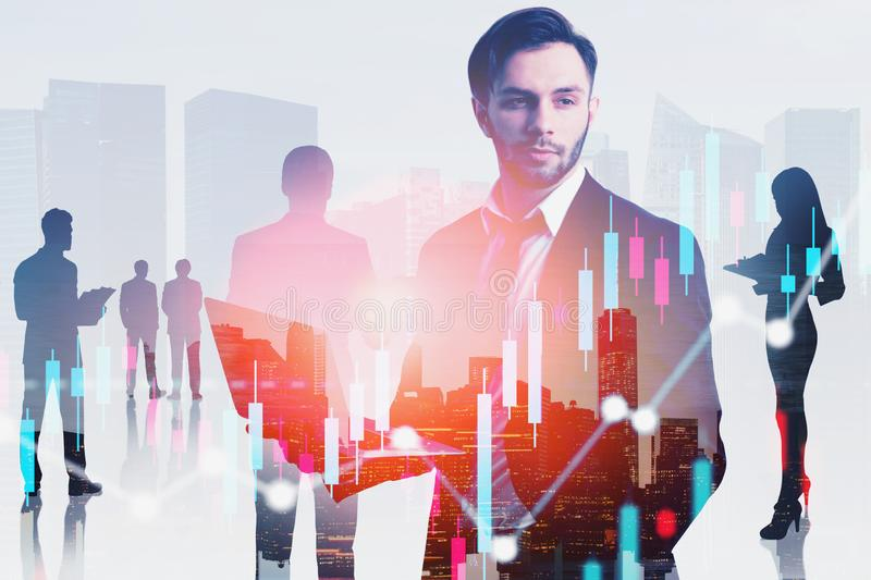 Business leader and his team in city, graphs stock images