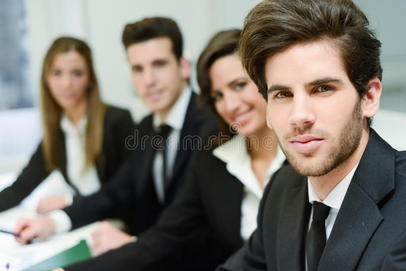 Business leader looking at camera in working environment. Image of business leader looking at camera in working environment stock images