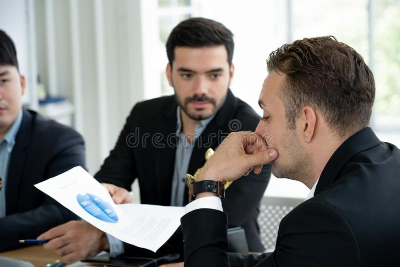 Business leader ponder market share paper from business man giving presentation royalty free stock photo