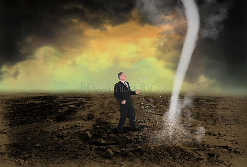 Business Leader Sales Profit Marketing. A businessman prepares to tackle a tornado storm funnel cloud. Business metaphor for leadership, being a leader, sales stock photo