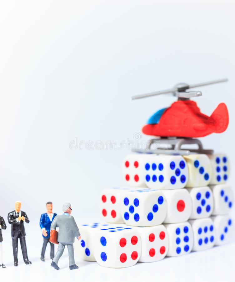 Business leader walking to chopper helicopter on dice steps of success, fast lane to financial freedom. Risk and Reward, royalty free stock image