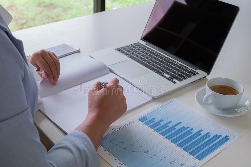 Business leader woman analyzing the charts and graphs for the new goal.  stock photo
