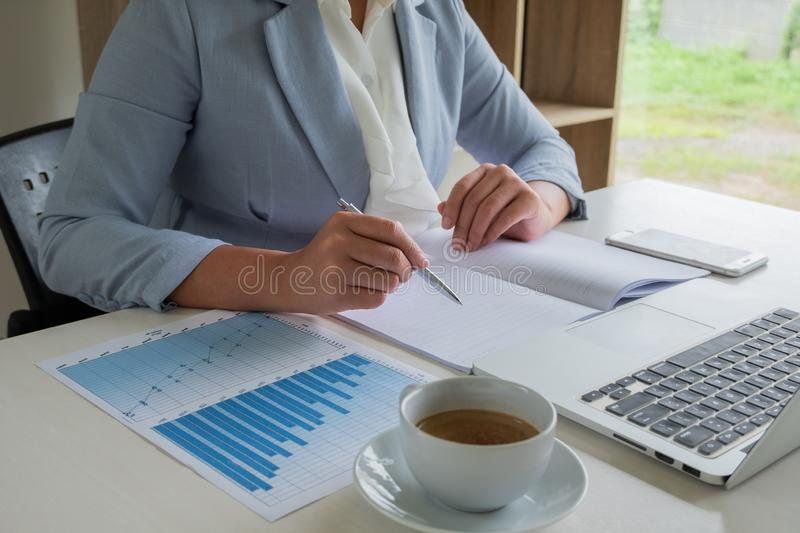 Business leader woman analyzing the charts and graphs for the new goal.  royalty free stock photos