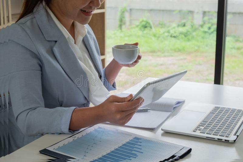 Business leader woman analyzing the charts and graphs for the new goal.  royalty free stock images