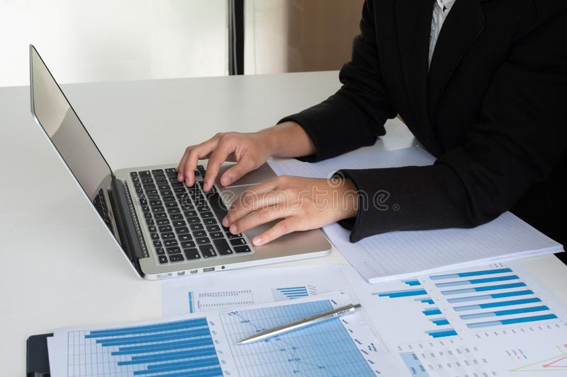 Business leader woman analyzing the charts and graphs for the new goal.  stock image