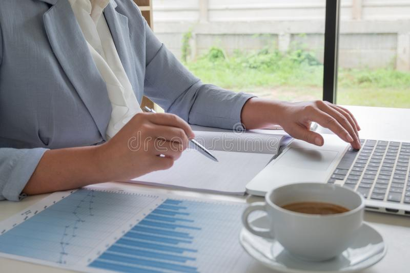 Business leader woman analyzing the charts and graphs for the new goal.  royalty free stock photo