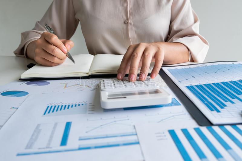 Business leader woman analyzing the charts and graphs for planning management new project royalty free stock image