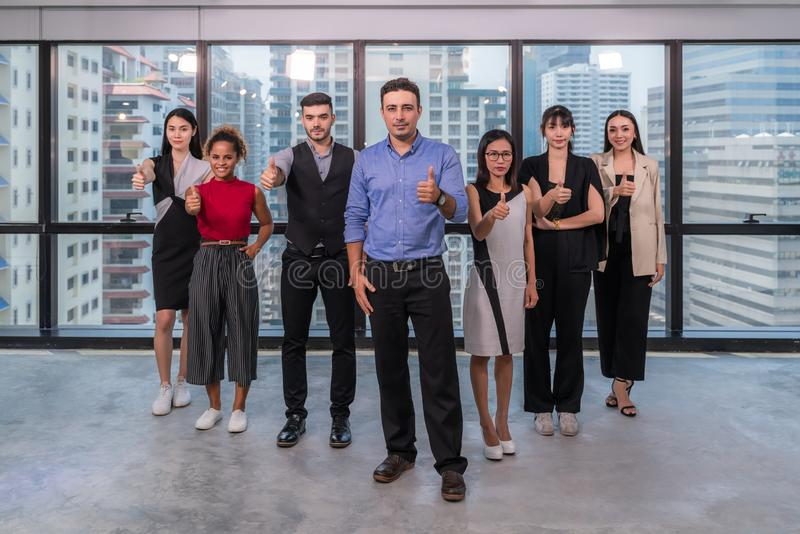 Business leaders with employees group showing thumbs up looking at camera, happy professional multicultural office team people stock images