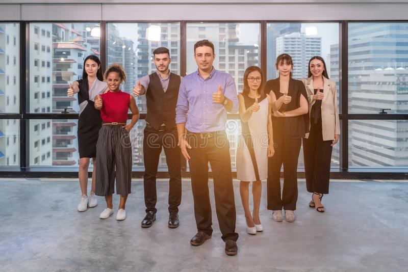 Business leaders with employees group showing thumbs up looking at camera, happy professional multicultural office team people royalty free stock photos
