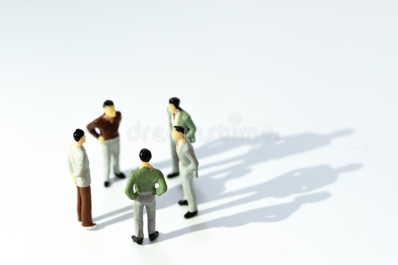 Business leadership, Teamwork power and confidence concept. Miniature people businessman small figure royalty free stock photography