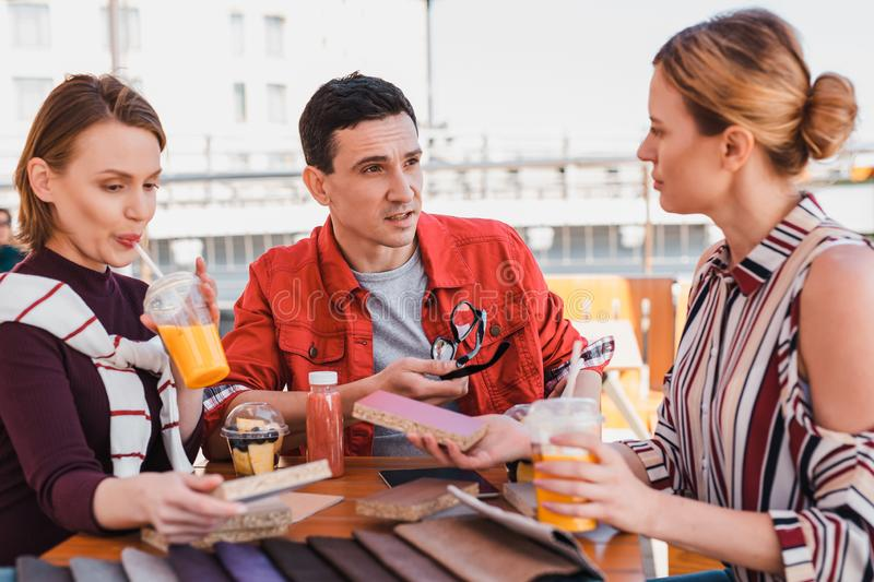 Project team taking business decisions while having lunch royalty free stock photography