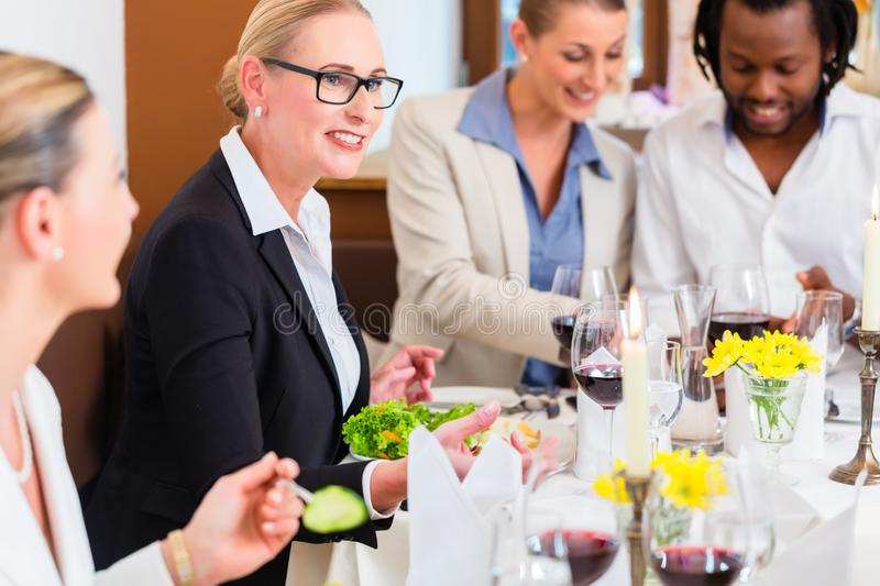 Business lunch in restaurant with food and wine royalty free stock photo