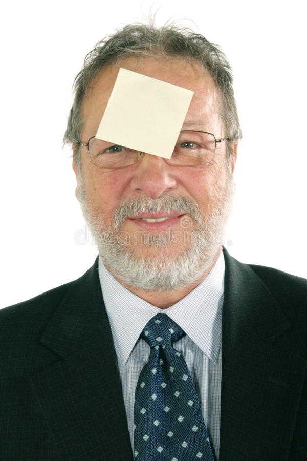 Business man. Mature business man with blanck message in forehead royalty free stock photos