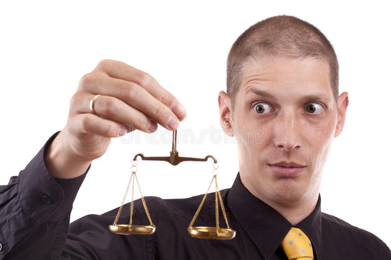 Business man. A business man holding a justice scale, isolated in white background royalty free stock photography