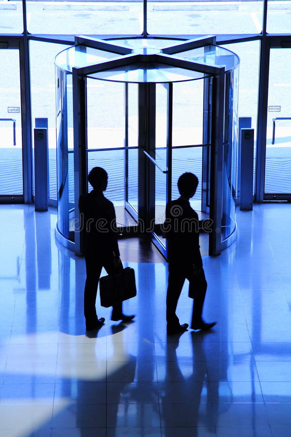 Business man. Two Young business man walking to the door stock photography