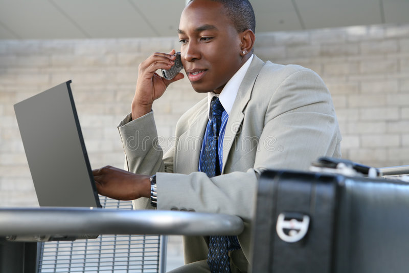 Business Man. A handsome business man working on his laptop computer royalty free stock photo