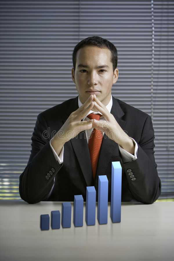 Business man with a 3D growth chart royalty free stock image
