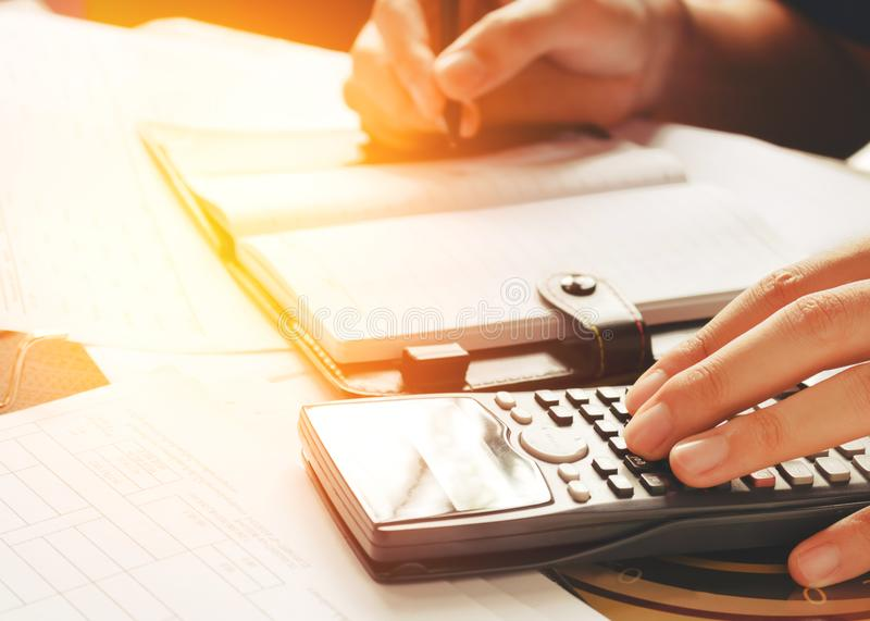 Business man accountant working at home with using calculator a. Nd writing make note about savings concept royalty free stock photography