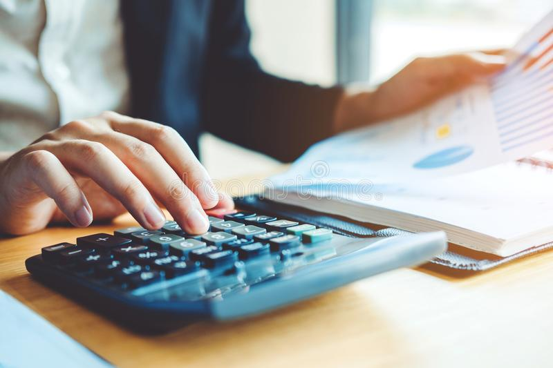 Business man Accounting Calculating Cost Economic Financial data stock photo