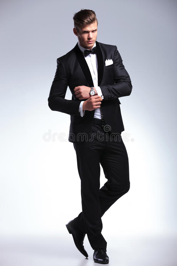 Business man adjusts his cufflinks stock photo