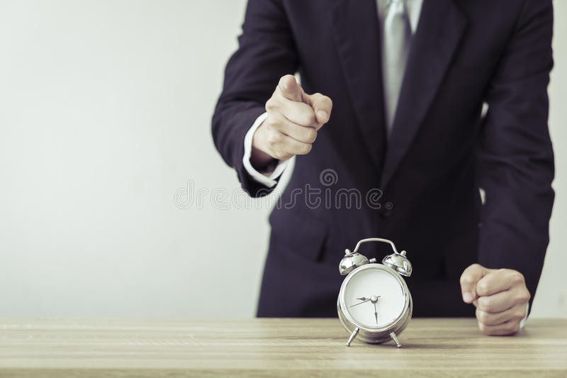 Business man with alarm clock. stock photography