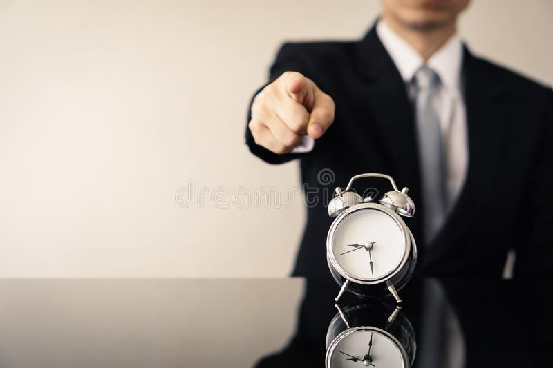 Business man with alarm clock. royalty free stock image