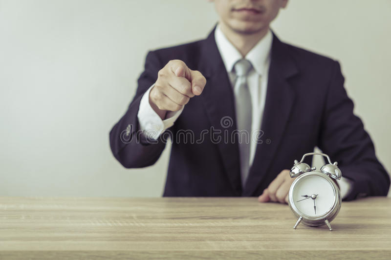 Business man with alarm clock. royalty free stock images