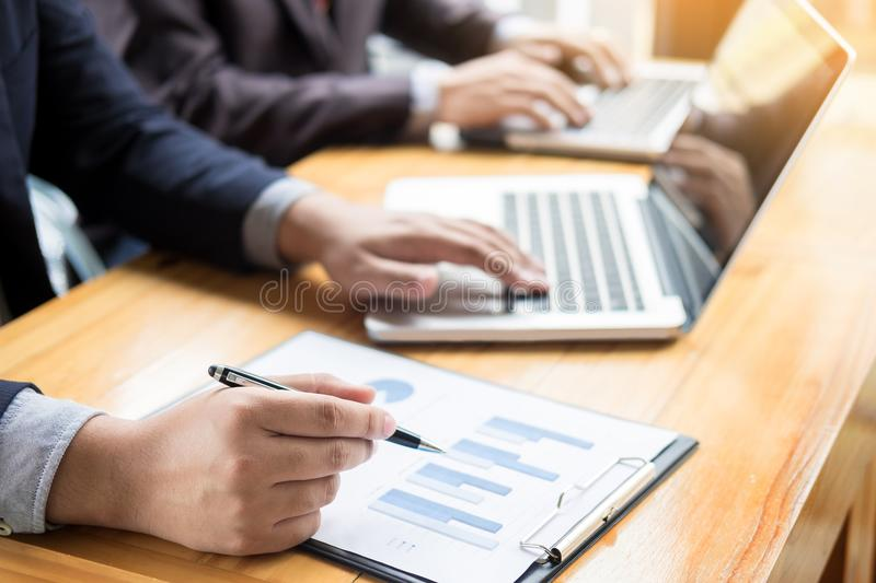 Business man analysed report of profit finance data graph document in his office. royalty free stock photography