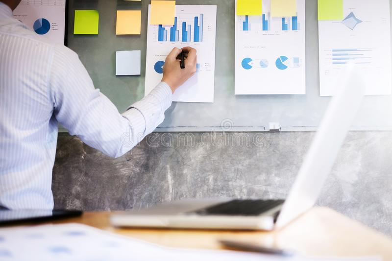 Business man analysis data document on the wall stock photo