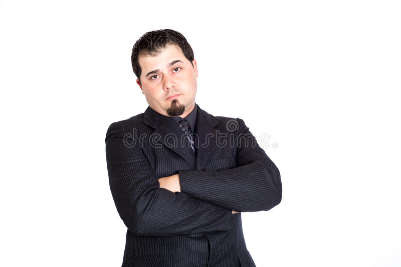 Business man arms crossed skeptical. A skeptical looking businessman with arms crossed. White background stock photos