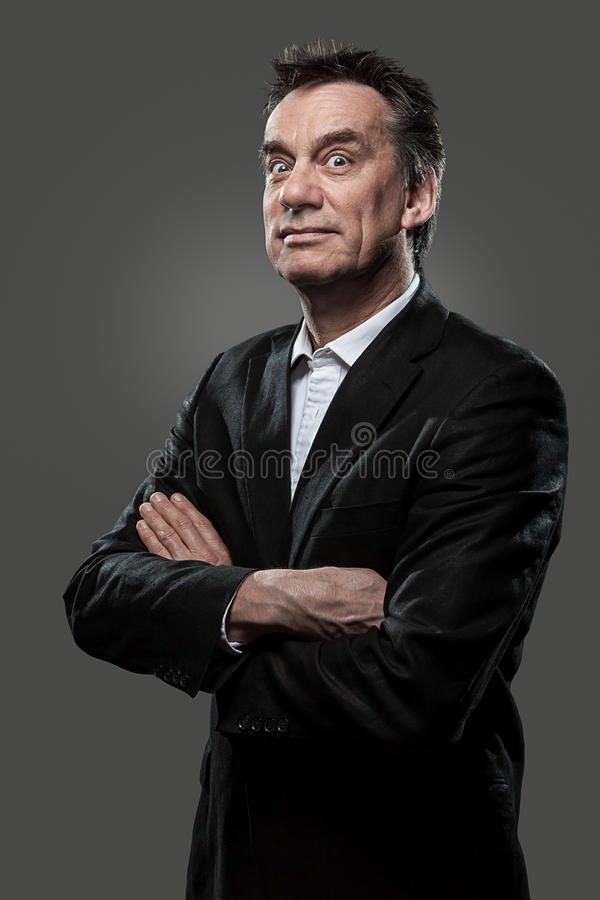 Free Business Man Arms Folded Pulling Face Grunge Look Royalty Free Stock Image - 24775416