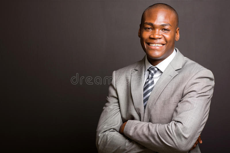 Business man arms folded stock image