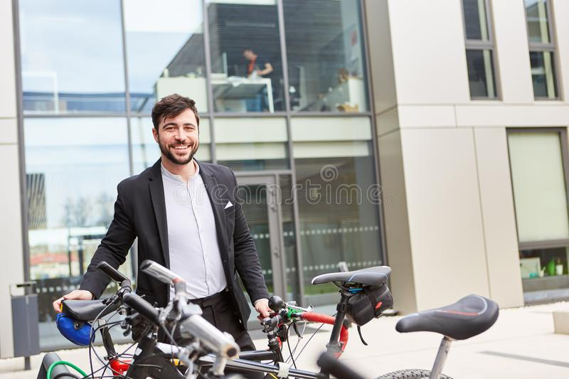 Business man as a climate-friendly cyclist stock photo