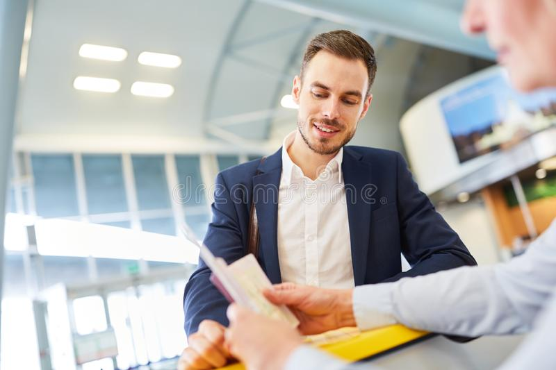Business man as a passenger at check in counter royalty free stock photos