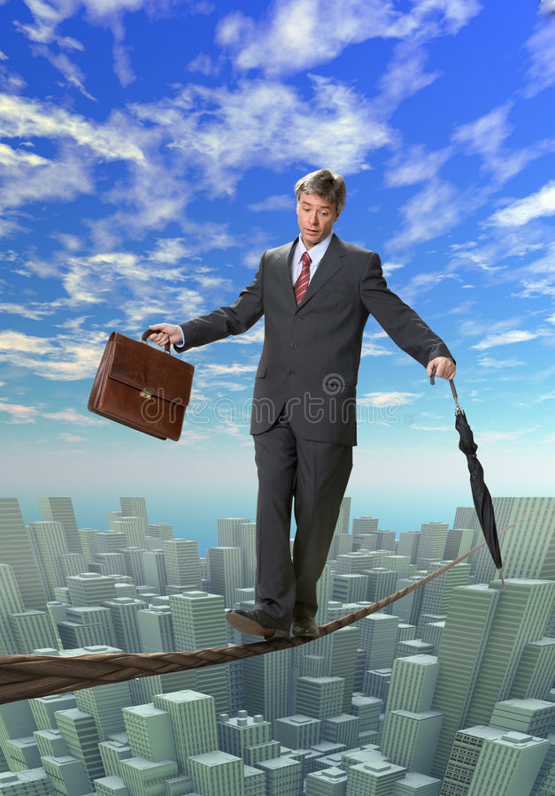 BUSINESS MAN BALANCING ON ROPE Stock Photography