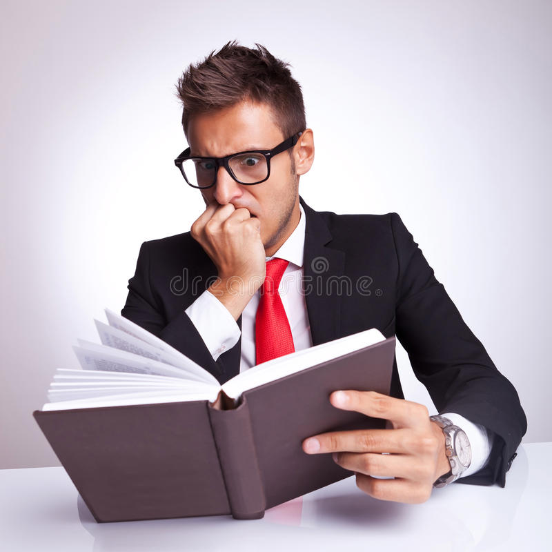 Free Business Man Being Affraid By The Book Royalty Free Stock Photos - 26587288
