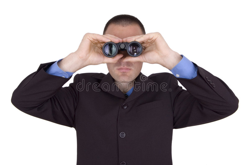Business man with binoculars. Business man searching for something over white stock images