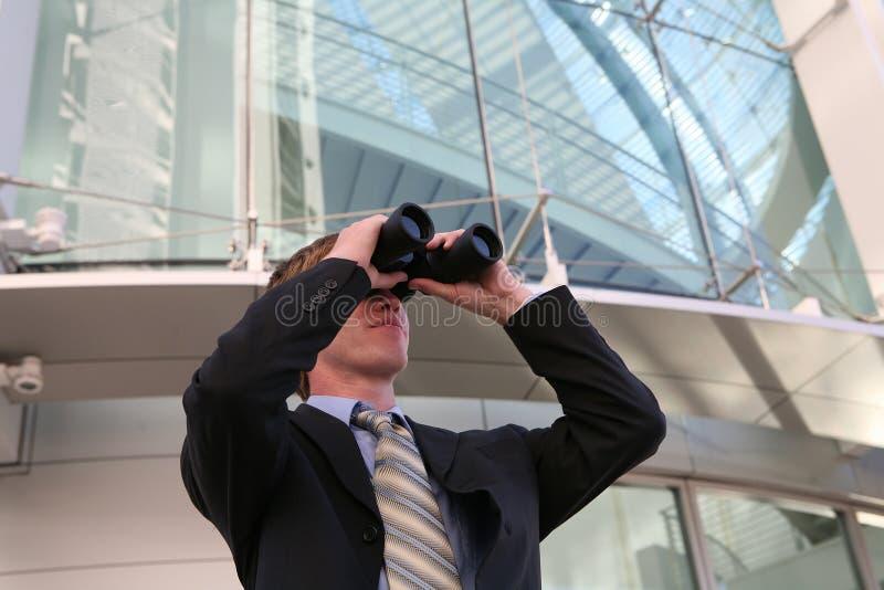 Business Man with Binoculars royalty free stock photo