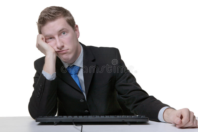 Business man bored at work royalty free stock images
