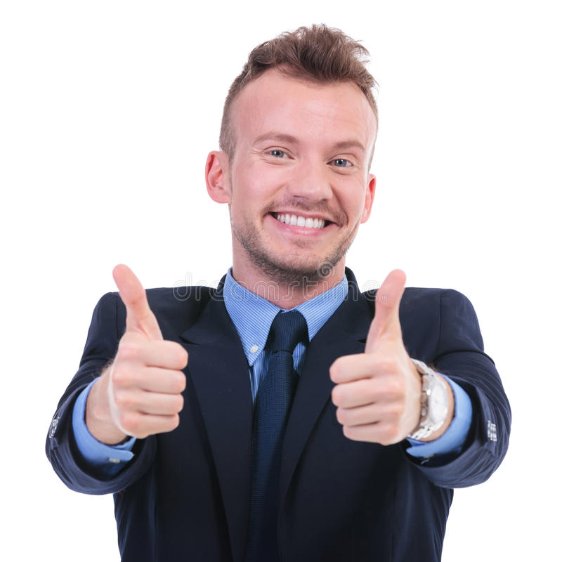 Business man with both thumbs up. Young business man shows thumbs up with both hands while smiling. on white background royalty free stock image