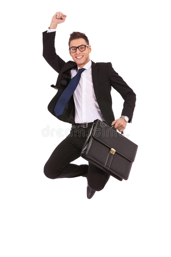 Business man with briefcase jumping royalty free stock photography